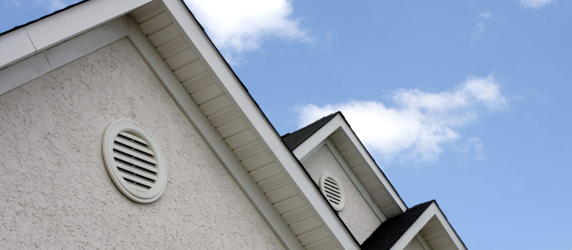 Close up of roof peaks against blue sky